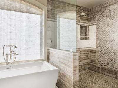 Bathtub and shower in new luxury home