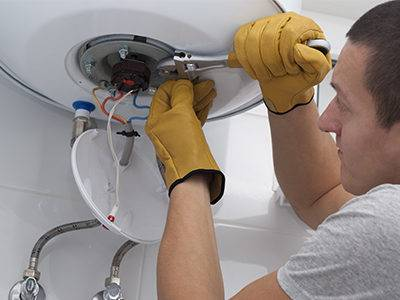 repairman-working-on-water-heater